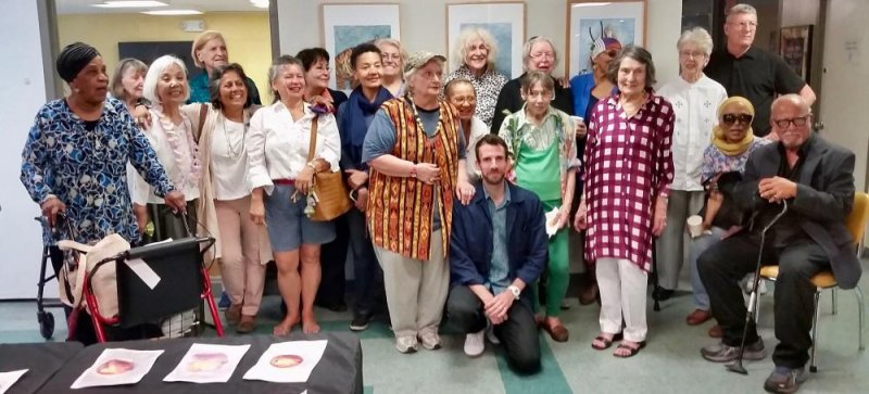 The lucky man kneeling in front of these lovely women artists is teacher Michael Sherman.