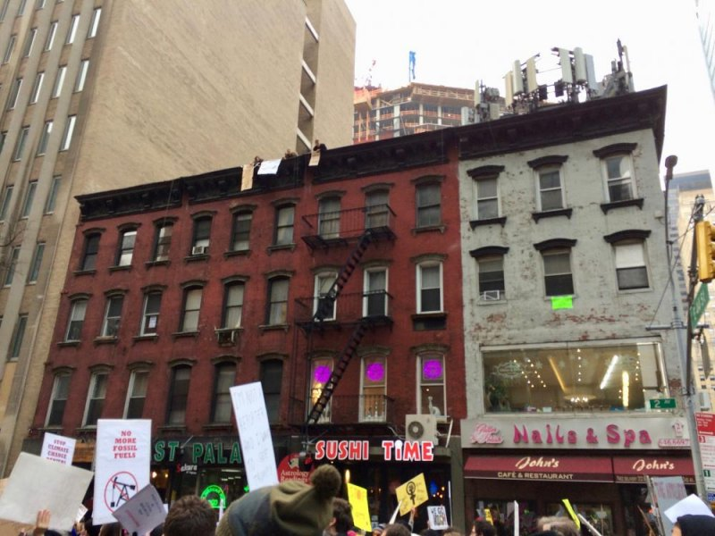At various points, supporters gathered on rooftops and in opened windows.