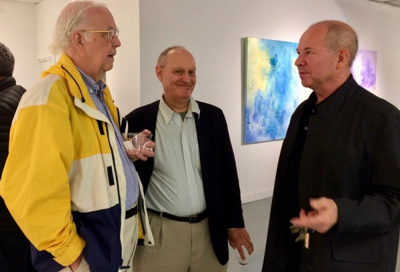 RIVAA President Tad Sudol talks art with visitors