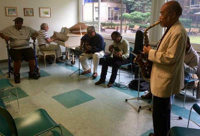 Susheel Kurien, third from left, led his lively jazz sextet as be bop danced through the Senior Center party.