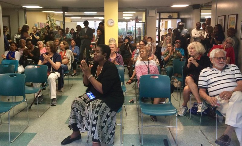 A capacity crowd enlivened the Senior Center.