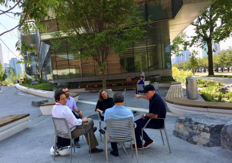 Andrew Winter (L) who has guided Cornell Tech's physical incarnation from ULURP through opening takes a break with associates in the shade of the Bloomberg Building.