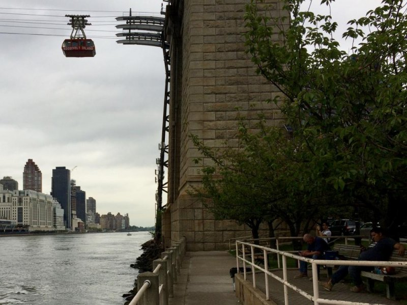 Meanwhile, a Tram cabin hangs suspended above the East River, disabled during Tram platform repairs.