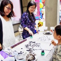 Eunkyoung Park conducts Muk- traditional Korean Ink painting classes