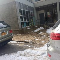 In an emergency, frightened children would be forced to slip and slide through snow, then maneuver around parked cars and end up in even more snow left in the alley after three days. Why is the school not concerned?