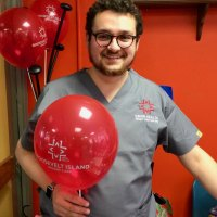 RI Urgent Care's Jack Laundau brightened the get together with red balloons