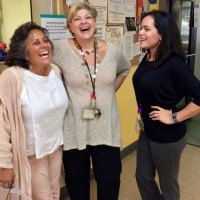 DASH Director Louella Streitz shares a laugh with Lisa Fernandez and Community Liaison Samantha Romero.