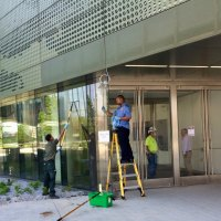 Workers busy preparing the Bloomberg's entrance for the upcoming Community Day.
