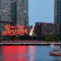 In Long Island City, crowds gathered under the Pepsi sign in Gantry Park.