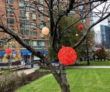 Festive? Hudson-RIOC replaced gray snowflakes and tipping over trees with a poverty of colored lights and bulbs...