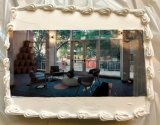 Island House's remodeled lobby, shown here decorating a cake, shared its grand opening with a Halloween Party for kids of all ages.