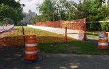 Along this temporary road will roll the future of Brooklyn and Queens
