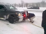 In January, 2016, Governor Cuomo, gloveless, hooked up a tow chain for a stuck motorist in Long Island.