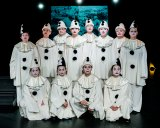 Actors appear in Pierrot costumes instead of uniforms to emphasis the anti-war theme.