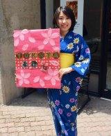 Aki Yamada invites visitors inside to try on a kimono.