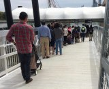 Lines to board NYC Ferry stretched to the end of the entrance bridge.