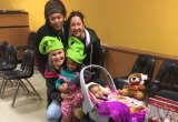 MST&DA Executive Director Kristi Towey (kneeling with a green hat) celebrated Christmas with needy children.