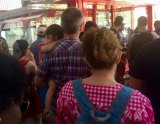 In the Roosevelt Island Tram Plaza, lines extended out past the turnstiles with one cabin shut down, the other operating at 50% capacity.