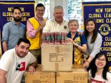 Jim Luce, second from left, joined Young Global Leaders and Lions as they dropped off 1,000 free glasses for seniors.
