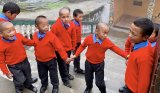 """The Guys."" At an orphanage for Tibetan Children, high in the Himalayas, supported by Roosevelt Island generosity."