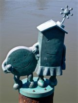 Marriage of Money and Real Estate: Tom Otterness, 1996, in the East River near Roosevelt Island