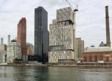 "Not ""directly across the water,"" One East River Place from 30 River Road, around a hundred yards up the river."