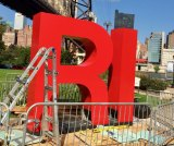 Close up view, RI Welcome Monument Sinks Its Feet Into Roosevelt Island