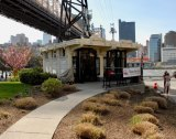 Roosevelt Island Visitor Kiosk, the view local residents say they want returned to the Tram Plaza.