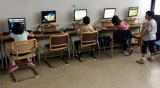 "Kids at the computers in the Roosevelt Island Youth Center on Wednesday after the Main Street WIRE said they'd been ""shut down."""