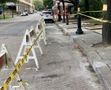 Sidewalk detours leads smack into a parked car. Walking in Main Street is your only option.
