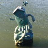 "Tom Otterness's ""Marriage of Money and Real Estate"" in the East River at Roosevelt Island"