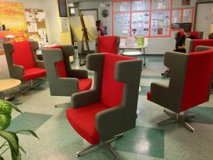 Lounge chairs donated by Cornell Tech replace a seldom used pool table.