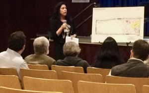 Diana Allegretti with charts showing current and future construction.