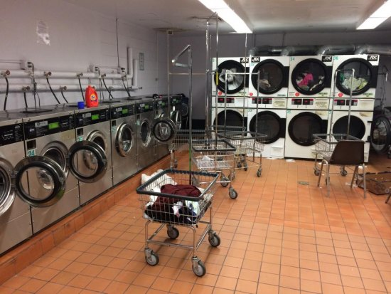 Manhattan Park Laundry Room at 4:00 a.m., abandoned laundry in driers and washers, debris on the floor. Facilities are forced to handle tenants far in excess of the number for which they were designed. The results are everywhere.