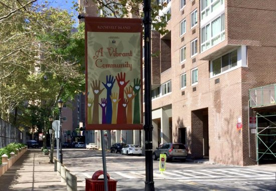 Lamppost banners like this one can be better used, according to Roosevelt Island historian Judy Berdy.