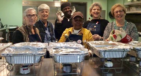 Volunteers: Mary Coleman, front, is surrounded by Wendy Hersh, Joyce Short, Amadou Keita, Lisa Fernandez and Judy Berdy