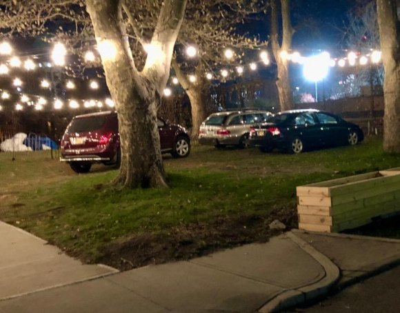 "For an apparent event on November 16th, The Sanctuary left its lot empty, parking on their lawn, future site of an ""outdoor beer garden,"" instead."