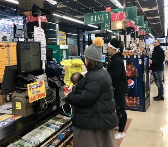 Shoppers Checking Out At Gristedes Faced Foodtown Welcome Signs