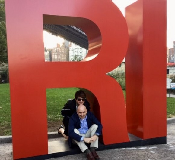 Co-presidents of Hudson Related's RIOC cuddle beneath the big red RI Sign they promised to remove if residents didn't like it. No poll was ever taken.