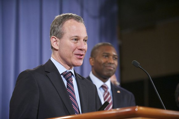 NYS Attorney General Eric Schneiderman in 2012. With him is Associate United States Attorney General, Tony West.