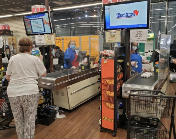 Plexiglass shields protect cashiers and shoppers.