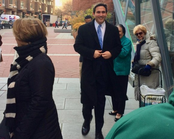 City Council Member Ben Kallos catches his breath after running up from the subway.