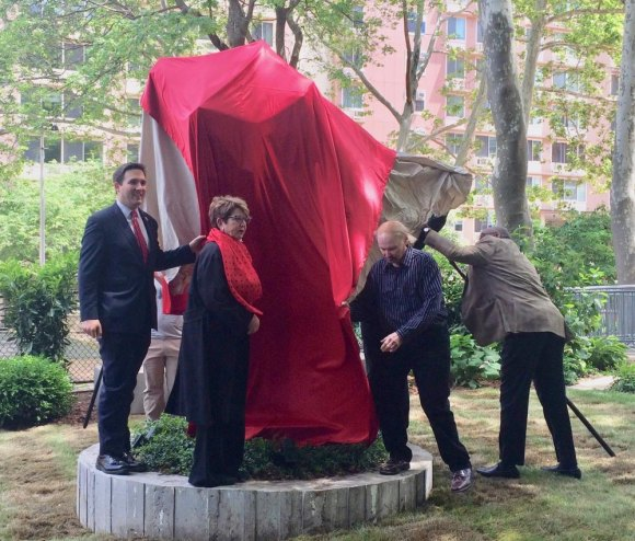 "Susan Rosenthal (red scarf) unveiling ""The Plinth,"" a new stop along the Island of Art Trail, last year."