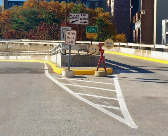 Metal spaghetti makes traffic signs nearly unreadable for drivers, but what we see is a ramp for bikes and cars with a safe 10 mph speed limit. For nothing.