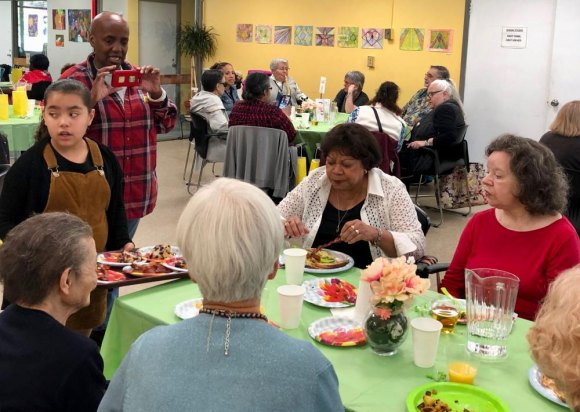 Moms and friends filled the Senior Center cafeteria for a brunch catered by Moving Forward's Teen Culinary Program.