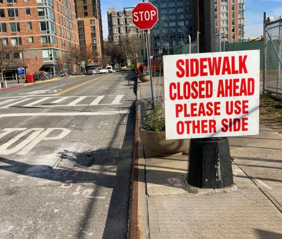 New signs were installed to steer pedestrians clear of a closed off crosswalk while it was still easy to do so.