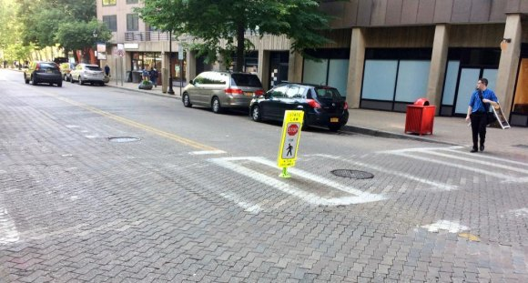 Near Rivercross, without the temporary sign, who could blame drivers for missing the crosswalk? It'll be invisible soon.