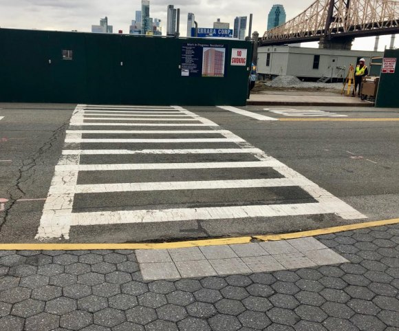 Crosswalk to Nowhere, including accessibility curb cut and no warning sign or nearby alternative.