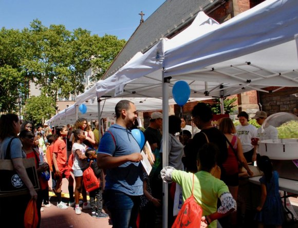 Locals and visitors packed the lineup of booths for Roosevelt Island Day.