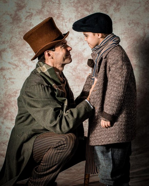 Russ Cusick as Bob Cratchit with Tiny Tim played by Jack Fadner